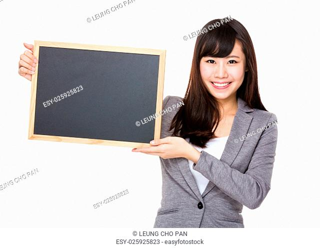 Young businesswoman showing the blank of chalkboard