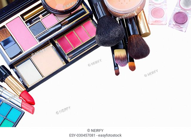 make up products and black brushes isolated on white