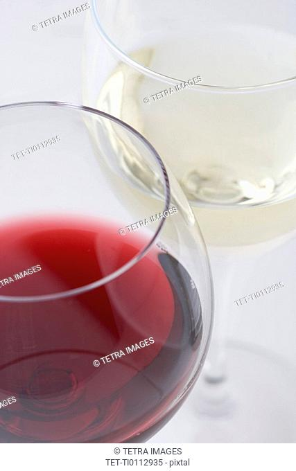 Glasses of white and red wine