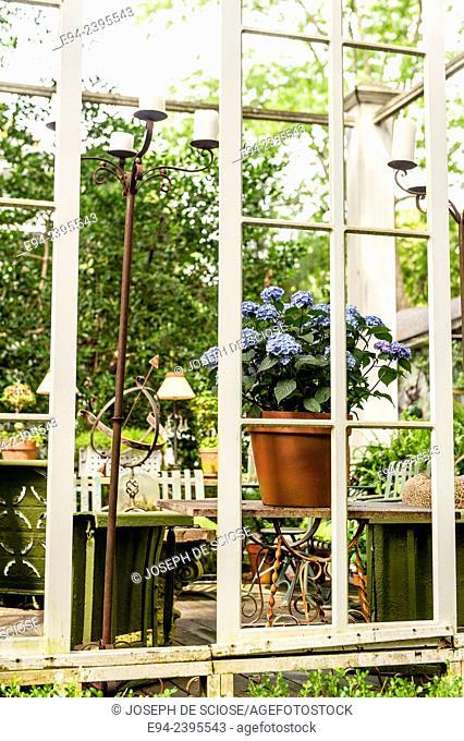 Outdoor living space in a garden setting featuring hydrangeas.Georgia USA