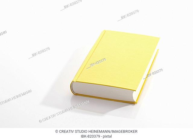 Hardcover book, blank unprinted yellow cover with no dust sleeve