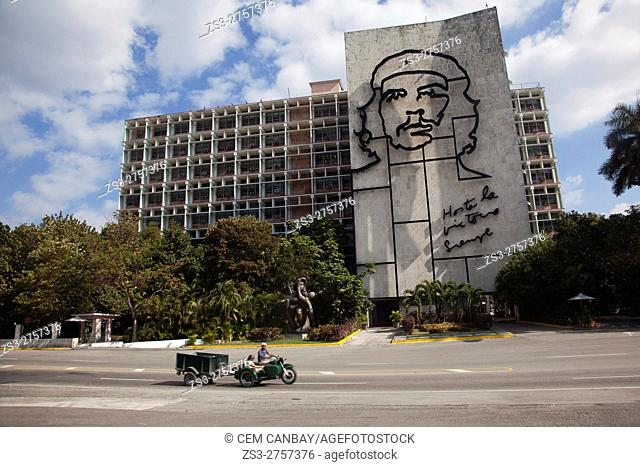 Motorcyclist in front of the Depiction of Ernesto 'Che' Guevara on the facade of the Interior of the Ministry building at the Plaza de la Revolucion square in...