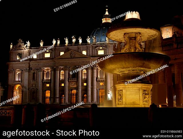 Cathedral and Fountain in Saint Peters Square at night