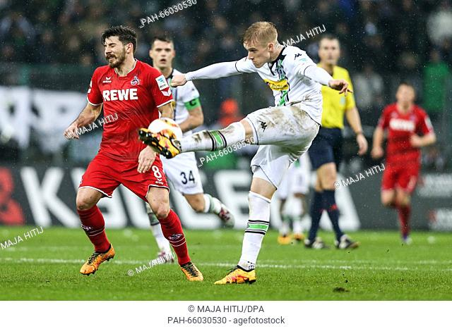 Gladbach's Oscar Wendt and Cologne's Milos Jojic vie for the ball during the German Bundesliga soccer match between Borussia Moenchengladbach and 1