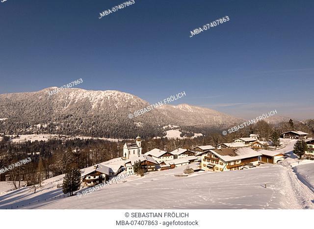 The snowy village Wamberg near Garmisch-Partenkirchen in winter. In the background the Wank