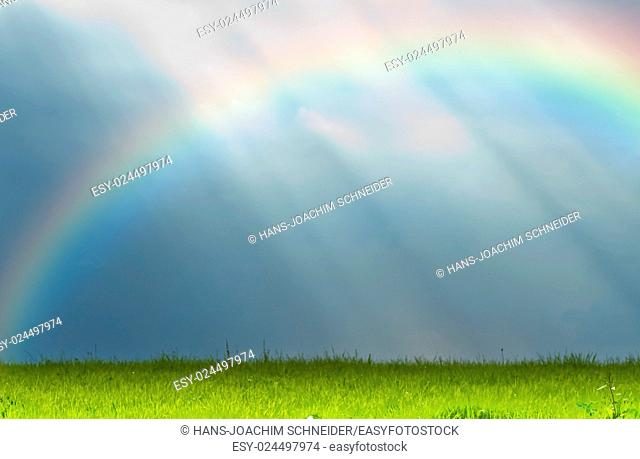 shafts of sunlight with rainbow