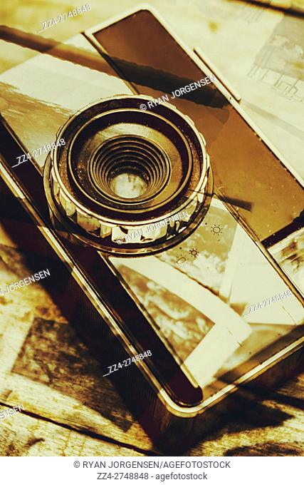 Artistic double exposure of a vintage photo tour or vacation in a sepia toned with a retro compact camera overlaid with captured moments