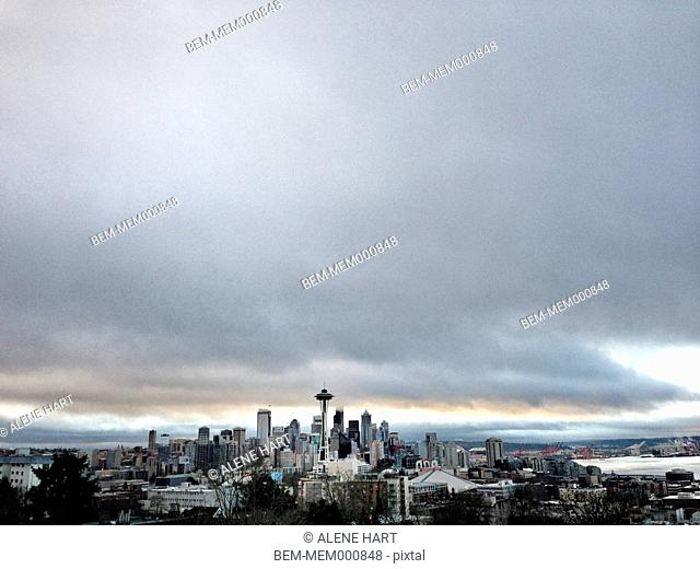 City skyline against cloudy sky, Seattle, Washington, United States