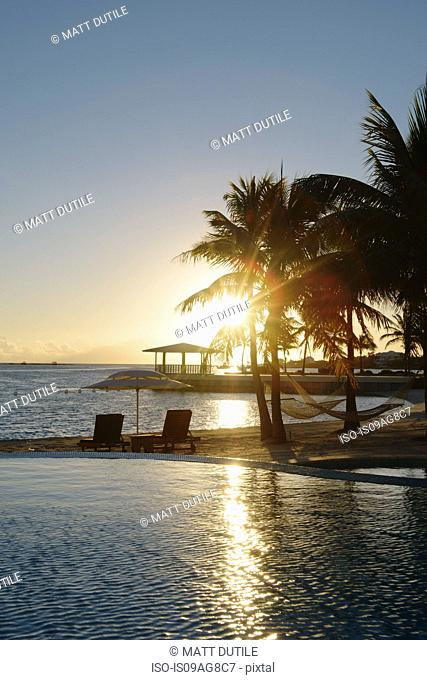 Sunset at coastal resort, Providenciales, Turks and Caicos Islands, Caribbean