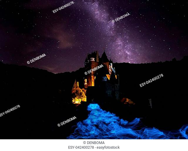 Milky way with light painting ghostly Castle Eltz