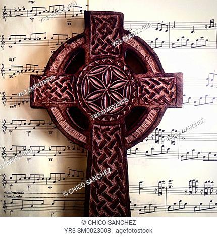 A celtic cross on top of a music sheet in Prado del Rey, Sierra de Cadiz, Andalusia, Spain
