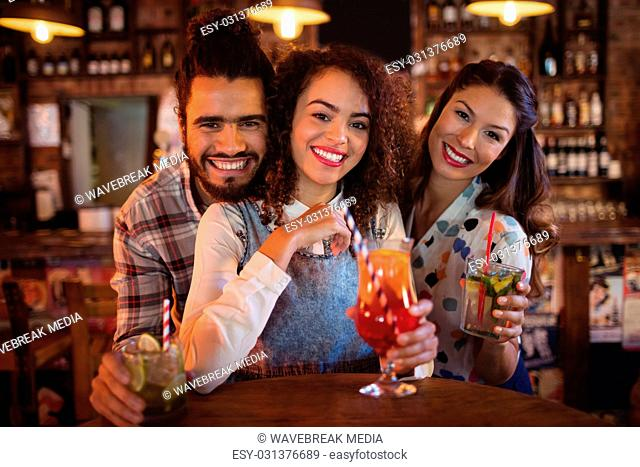 Portrait of young friends having drinks