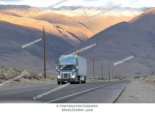 Semi-truck driving on mountain road