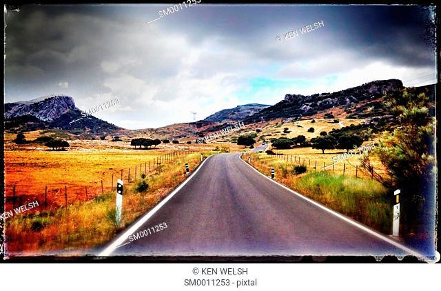 Landscape. Lonely road in the Serrania de Ronda, Malaga Province, Andalusia, southern Spain