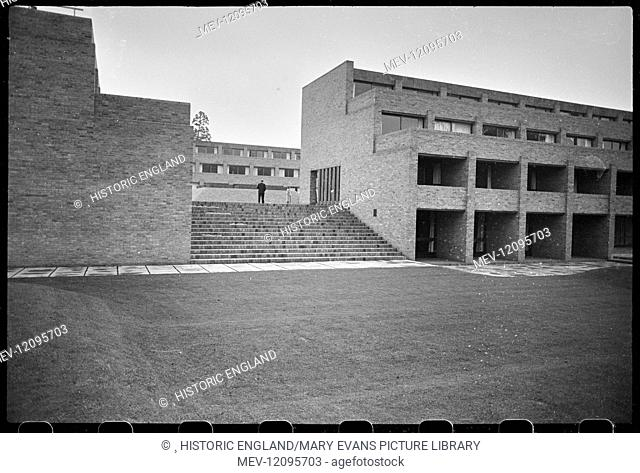 Exterior view of Harvey Court, student residences built between 1960-62 surrounding a square raised courtyard, seen from the south and looking up the stairs in...