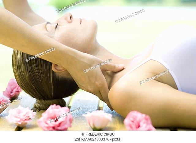 Woman having neck massage