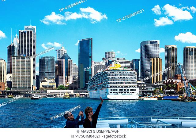 Australia, Sydney, touirsts on a boat with the Quay Staion towers in the background