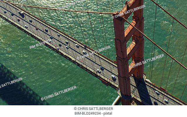 Aerial view of cars driving on bridge