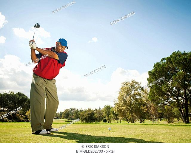 Black man playing golf