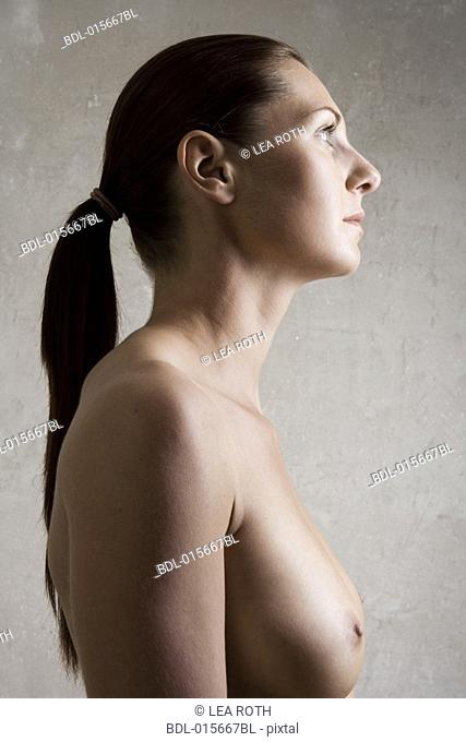 portrait of naked young woman in profile