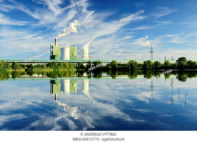 Germany, Saxony-Anhalt, Schkopau, brown coal power station is reflected in pond