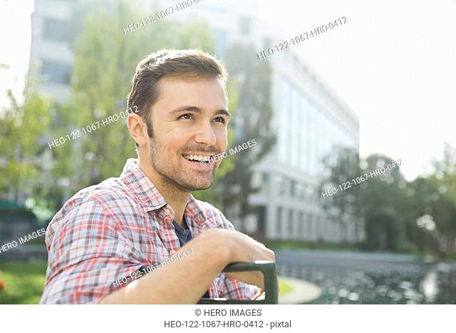 Smiling man looking away outdoors