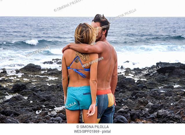 Spain, Tenerife, couple standing on the beach at seaside
