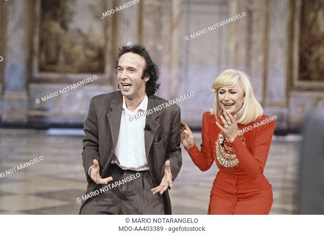Roberto Benigni e Raffaella Carrà laughing in Fantastico 12. Italian actor and director Roberto Benigni and Italian showgirl Raffaella Carrà (Raffaella Maria...