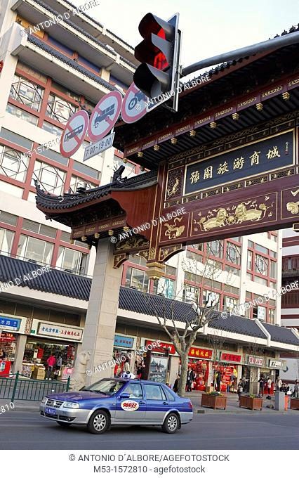 A taxi car crossing a traditional chinese portal located in Lishui Road  Shanghai  China