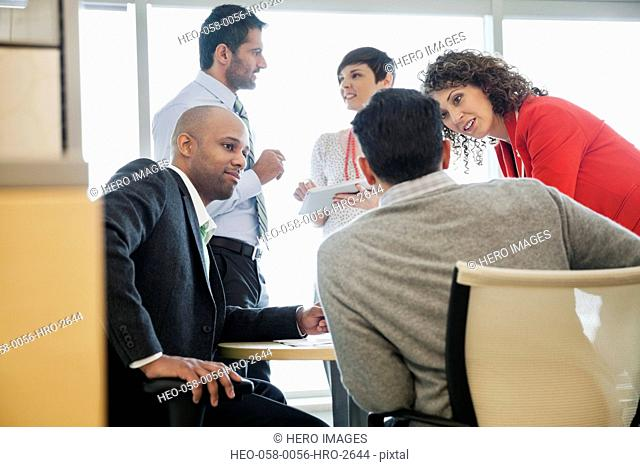 Group of business people in discussion in office