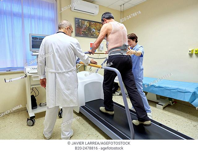 Doctor and nurse performing cardiac stress test on patient, Hospital Donostia, San Sebastian, Basque Country, Spain