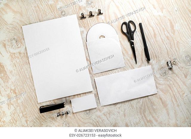 Blank stationery set on light wooden background. Mockup for branding identity