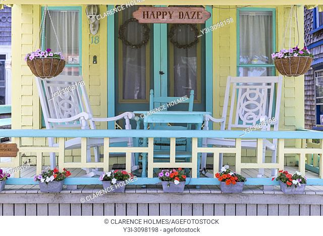 The front porch of a colorful gingerbread cottage in the Martha's Vineyard Camp Meeting Association (MVCMA) in Oak Bluffs, Massachusetts