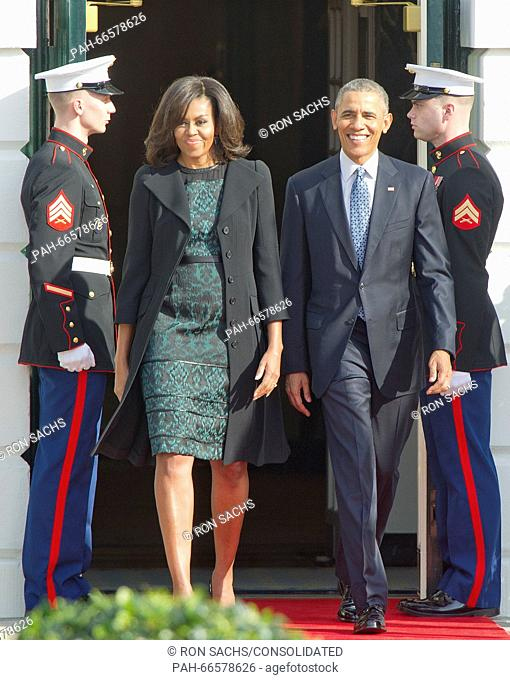 United States President Barack Obama and First Lady Michelle Obama walk out of the Diplomatic entrance prior to hosting an Arrival Ceremony opening the Official...