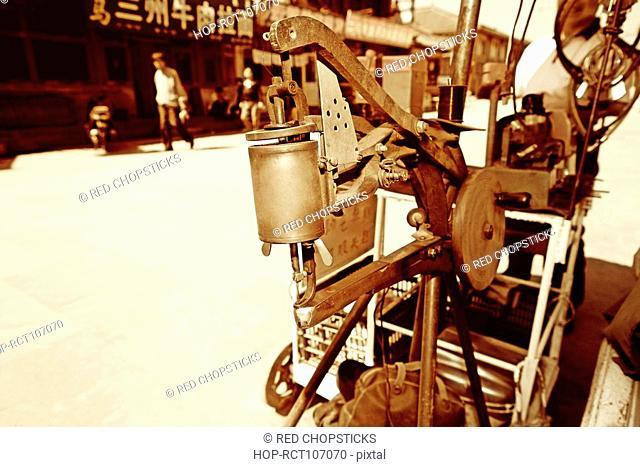 Shoe making machine at the roadside, HohHot, Inner Mongolia, China