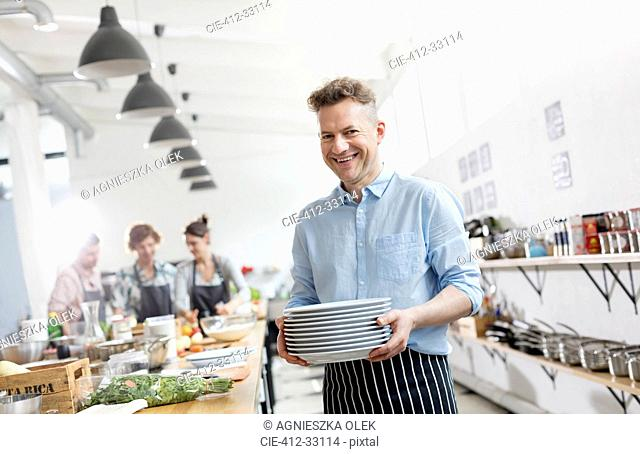 Portrait smiling man in cooking class kitchen