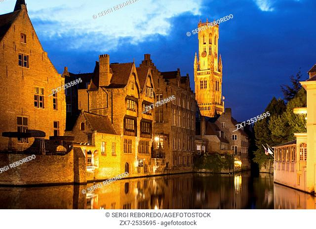 Bruges at night with the Belfry in the background, the most tipical landscape in Bruges. Evening view over Bruges : the Dijver canal and the Belfry tower