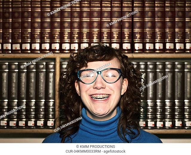 Woman with glasses and braces in library