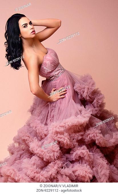 Brunette girl beautiful violet dress