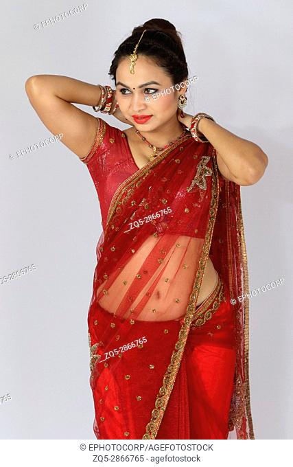 Young Indian girl in red traditional sari