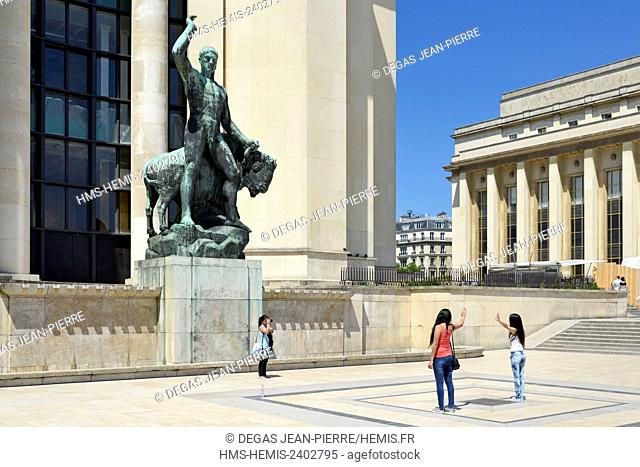 France, Paris, area listed as World Heritage by UNESCO, Palais de Chaillot, tourists photographing in front of a statue