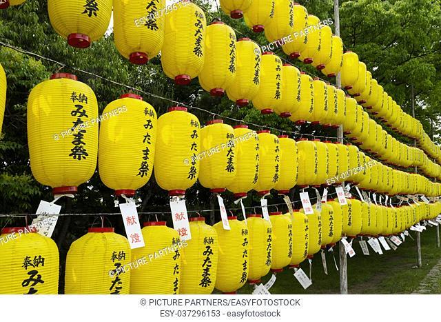 Yellow lanterns with the names of supporters at the Manto mitama matsuri at the entrance of the Hiroshima Gokoku-jinja Shrine