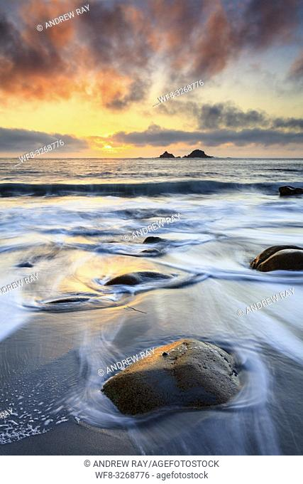 The Brison Rocks captured at sunset from the beach at Porth Nanven near St Just in the far west of Cornwall