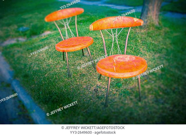 Ugly orange chairs curb side for trash pickup in Ludington, Michigan, USA