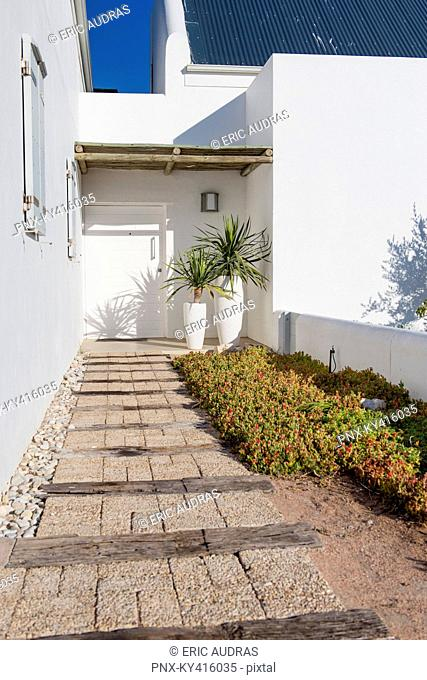 Path leading towards the entrance of a house