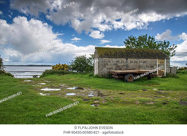 Fisherman hut for servicing stake or trap fishing nets used to catch salmon and trout on coast, Solway Firth, Annan, Dumfries, Dumfries and Galloway, Scotland