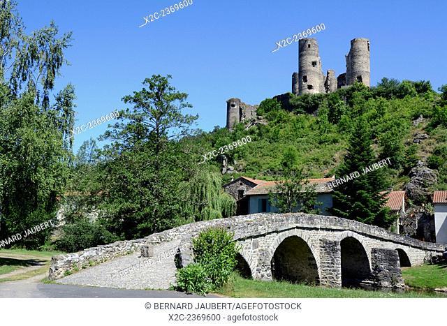 Old stone bridge in front of Château de Domeyrat castle, Domeyrat, Haute-Loire, Auvergne, France, Europe
