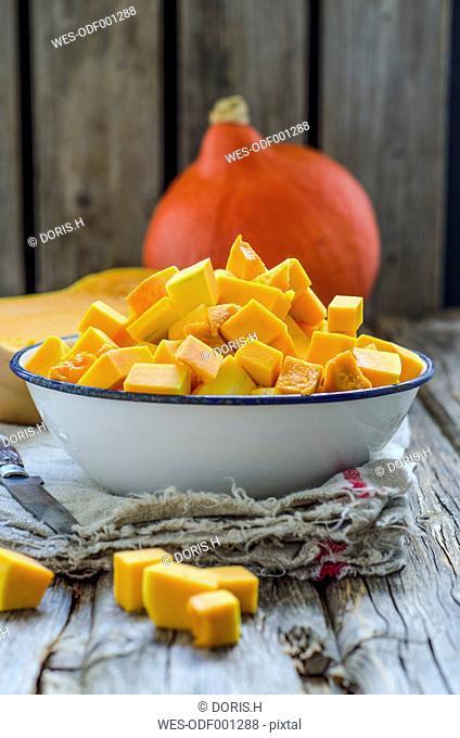 Hokkaido pumpkin and butternut squash, chopped in bowl