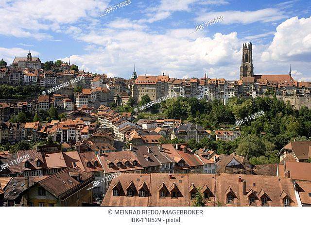Old part of Freiburg/Fribourg, Switzerland, with the Cathedral St. Niklaus. Freiburg is situated on the linguistic border of the french- to the german-speaking...