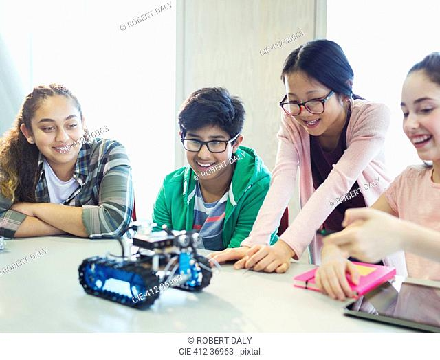 Students programming and testing robotics in classroom